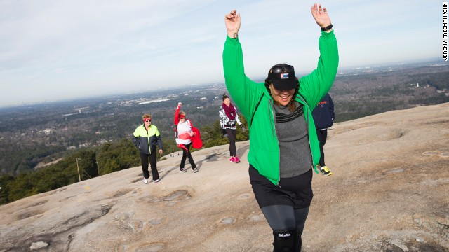 Sia Figiel reaches the top of Stone Mountain during the Fit Nation kickoff weekend in Atlanta.
