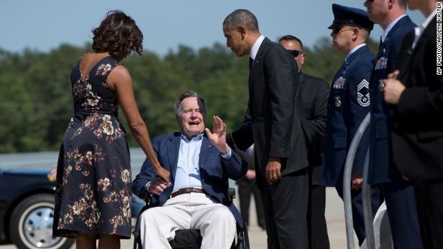 George H. W. Bush greets Obamas