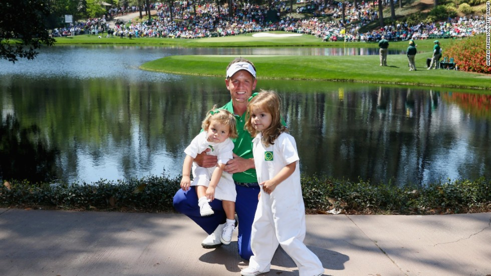 England's Luke Donald poses with his daughters Elle and Sophia Ann at Augusta.