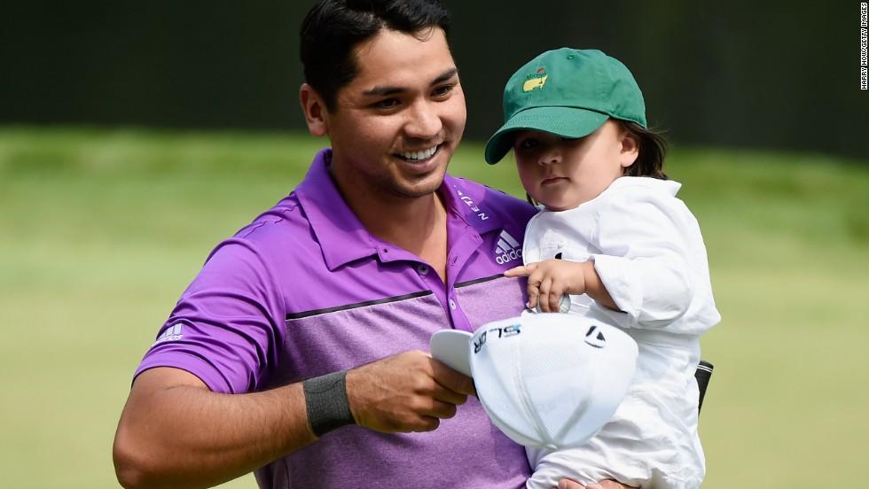 World No.4 Jason Day of Australia shows his son, Dash, around the course at Augusta.