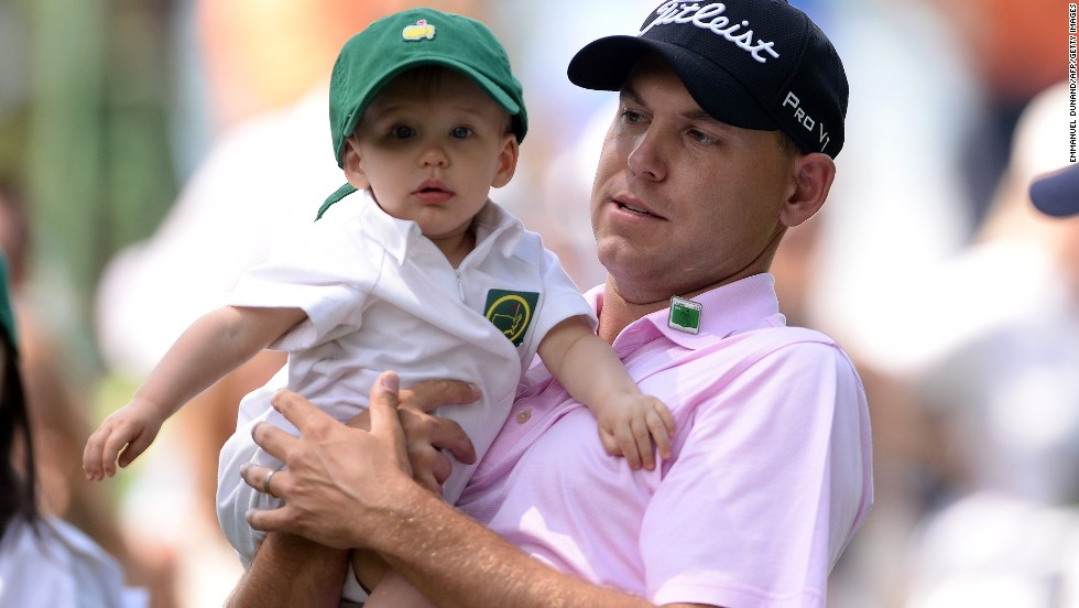 Bill Haas shows his son William around the place as the crowds gather to watch Wednesday's action.