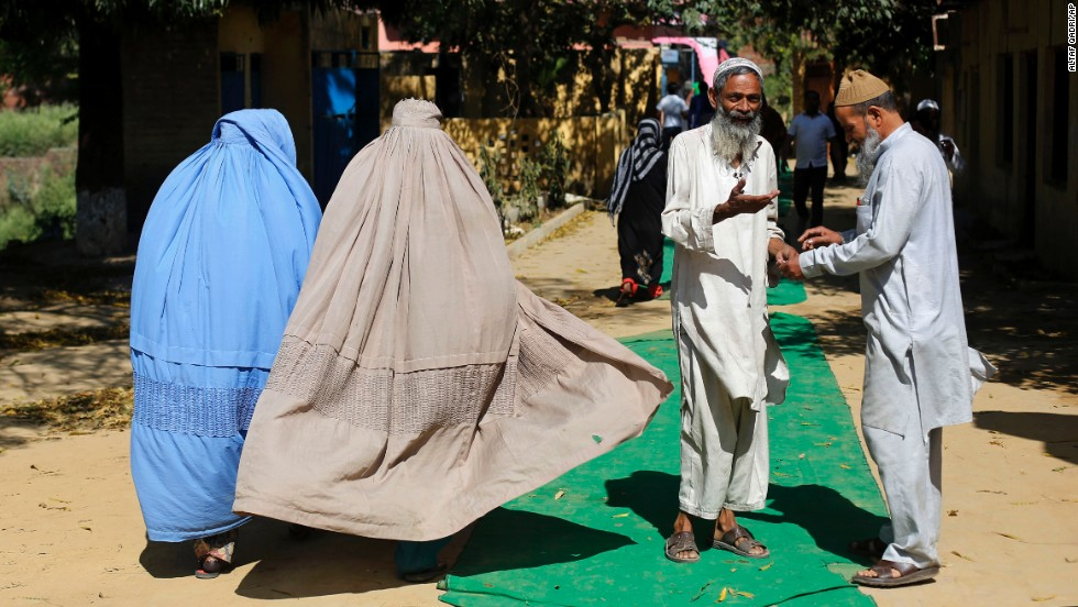 Voters leave a polling station in Muzaffarnagar on April 10.