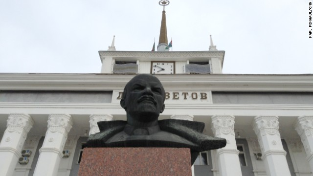 A statue of Lenin guards a building with the Soviet star still on top in Transnistria.
