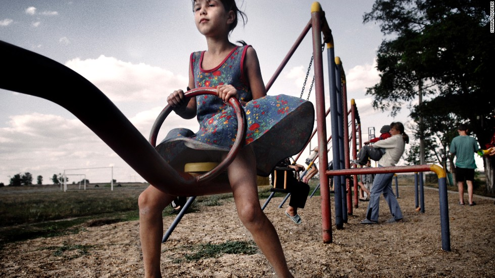 A child enjoys a Transnistrian playground.
