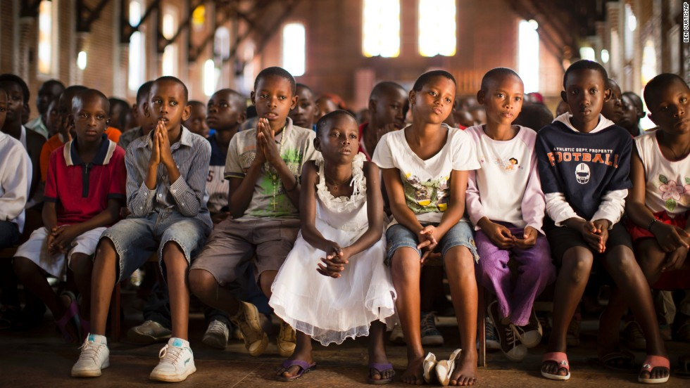 "Children pray at a Catholic church in Kigali, Rwanda, on Sunday, April 6. Twenty years ago this month, mass killings began in Rwanda. An estimated 800,000 civilians, mostly from the Tutsi ethnic group, <a href=""http://cnnphotos.blogs.cnn.com/2014/04/03/like-being-in-the-valley-of-death/"">were murdered</a> over a period of about 100 days."