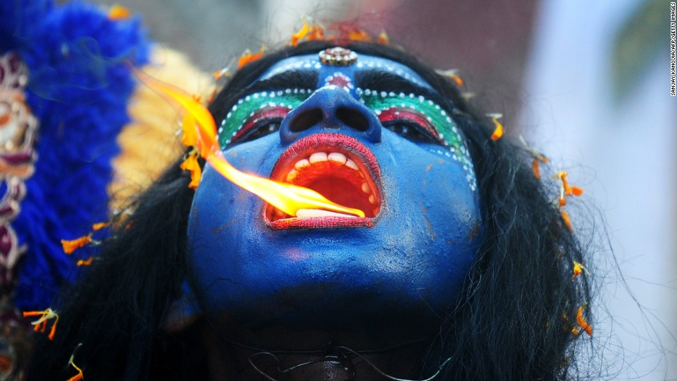 An artist dressed as the Hindu goddess Kali participates in a procession to celebrate the Ram Navami festival Tuesday, April 8, in Allahabad, India.