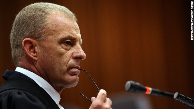 Gerrie Nel looks on while cross-examining South African Olympic and Paralympic sprinter Oscar Pistorius during his trial at the North Gauteng High Court in Pretoria on April 9, 2014.