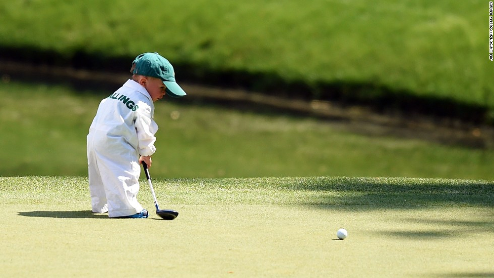 Finn Stallings, the young son of professional golfer Scott Stallings, putts on a green during the Masters' Par 3 contest, held Wednesday, April 9, in Augusta, Georgia.