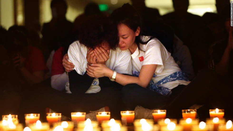 "A woman cries in Beijing during a candlelight vigil held Tuesday, April 8, for those aboard Malaysia Airlines Flight 370. Authorities are <a href=""http://www.cnn.com/2014/03/07/asia/gallery/malaysia-airliner/index.html "">combing the southern Indian Ocean</a> in search of Flight 370, which disappeared March 8."