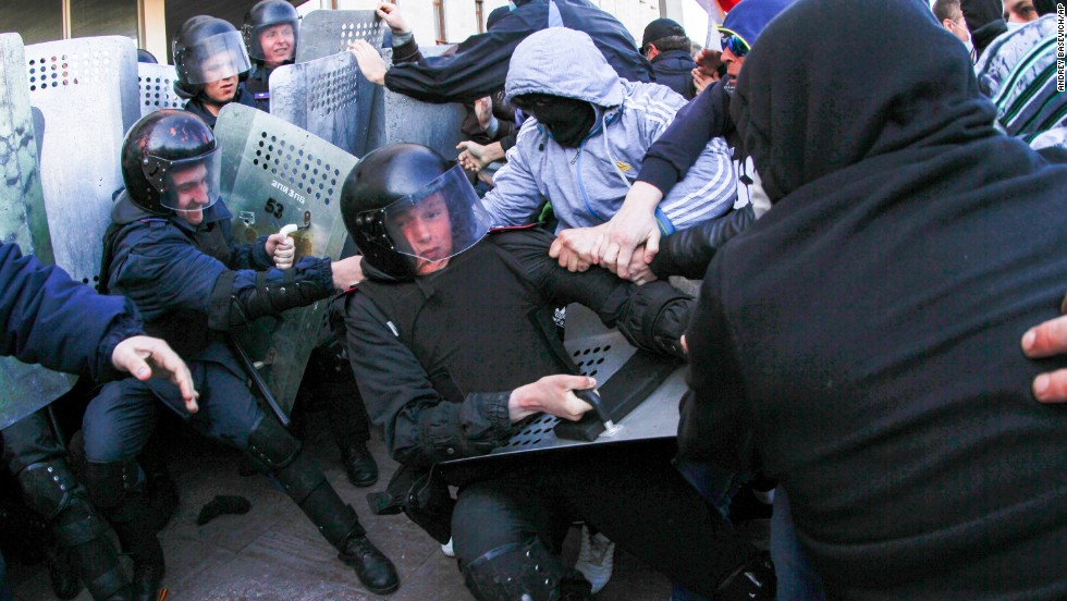 "Pro-Russian activists clash with police at the regional administration building in Donetsk, Ukraine, on Sunday, April 6. Protesters <a href=""http://www.cnn.com/2014/03/26/world/gallery/ukraine-crisis/index.html "">seized state buildings</a> in several east Ukrainian cities, prompting accusations from Kiev that Moscow is trying to ""dismember"" the country."