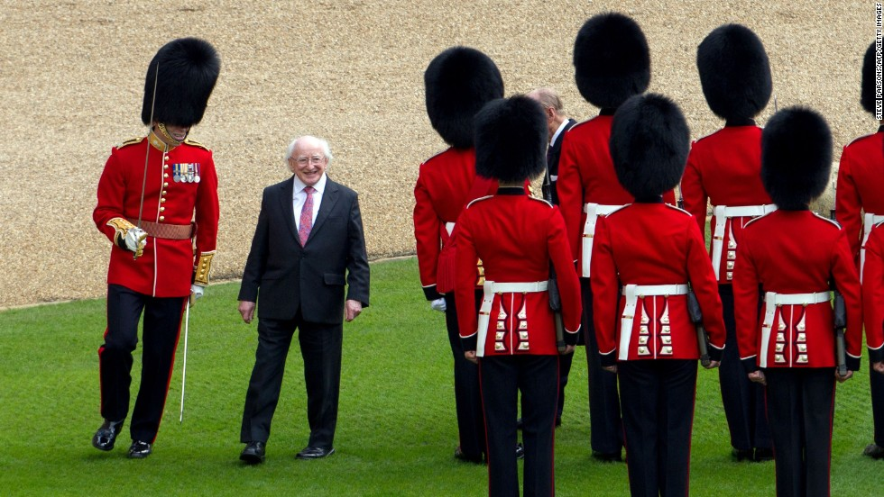 "Irish President Michael D. Higgins inspects a guard of honor at Windsor Castle, west of London, on Tuesday, April 8. Higgins is the first Irish head of state to make a <a href=""http://www.cnn.com/2014/04/09/europe/gallery/irish-president-state-visit-britain/index.html"">state visit</a> to the United Kingdom. <a href=""http://www.cnn.com/2014/04/04/world/gallery/week-in-photos-0403/index.html"">See last week in 33 photos</a>"