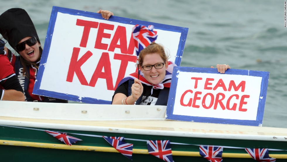 Fans of the royal family cheer them on as they race yachts in Auckland on April 11.