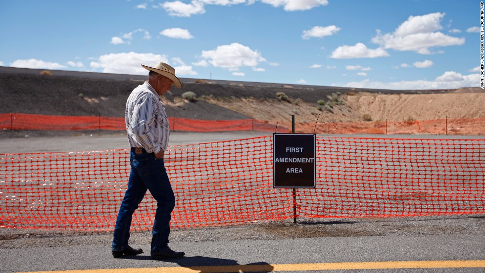 Bundy walks by a free speech area set up by the Bureau of Land Management on Tuesday, April 1.