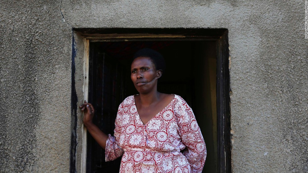 Alphonsine Mukamfizi, 42, who survived three attempts on her life and had to fake death to survive, poses at her home in Nyamata, a small town outside Kigali. The rest of her 11 family members were killed in the 1994 genocide.