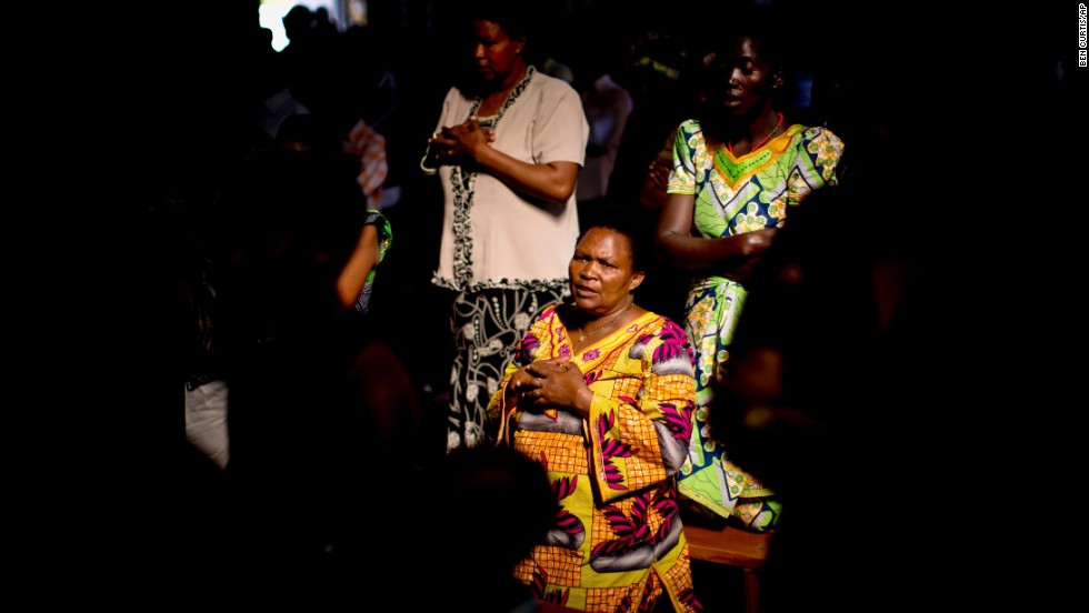 Members of the Sainte-Famille Catholic Church congregation pray during a Sunday morning service in Kigali on April 6. The church was the scene of many killings during the 1994 genocide.