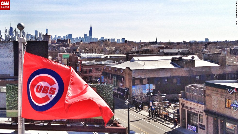 "Swathi Sridhara was born and raised as a Cubs fan. This year is the first time she has season tickets. Sridhara shot this scene from <a href=""http://ireport.cnn.com/docs/DOC-1119014"">Wrigley Field</a> on opening day."