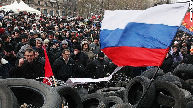 Pro-Russian activists rally at a barricade outside the regional state administration in the eastern Ukrainian city of Donetsk on April 11, 2014. Ukraine's embattled premier vowed on Friday to grant more power to the country's regions in a bid to stamp out a separatist insurgency that sprang up just as a new Russian gas war threatened European supplies. Prime Minister Arseniy Yatsenyuk's promise during a visit to the coal mining region of Donetsk came as militants armed with Kalashnikovs barricaded themselves inside the local government building and demanded a referendum on joining Russia. AFP PHOTO/ ANATOLII STEPANOVANATOLII STEPANOV/AFP/Getty Images