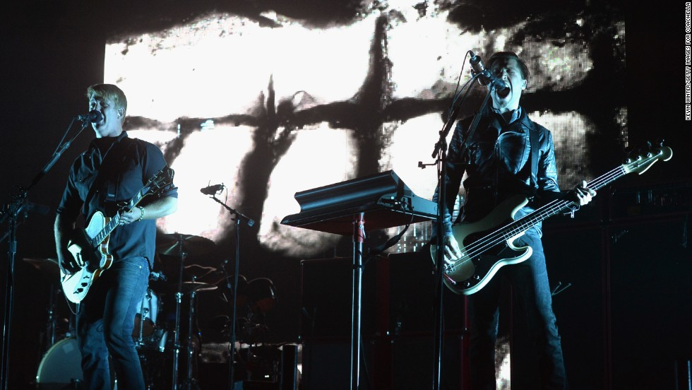 Josh Homme, left, and Michael Shuman from Queens Of The Stone Age perform on April 12.