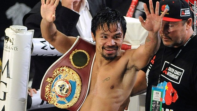 Manny Pacquiao celebrates his points victory over Timothy Bradley in Las Vegas in their world title bout.
