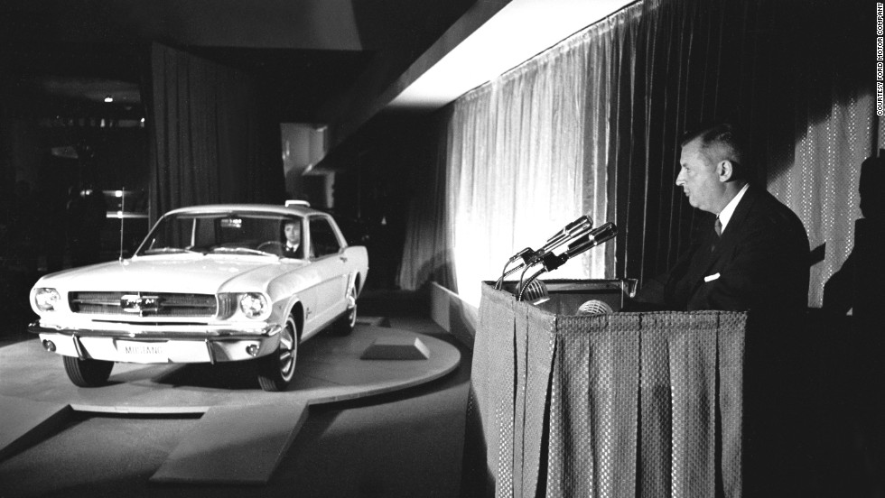 "<a href=""http://money.cnn.com/gallery/autos/2014/04/17/ford-mustang-50th-anniversary.fortune/"">The 1965 Ford Mustang</a> was first officially revealed to the public at the 1964 World's Fair in New York. Standard equipment included carpet, bucket seats and a 170-cubic-inch, six-cylinder engine that was coupled with a three-speed floor-shift transmission. With a price that started at just under $2,400, the car captured America's affection and <a href=""http://www.cnn.com/2014/04/15/living/gallery/50-years-of-mustang/"">is still being produced today</a>."