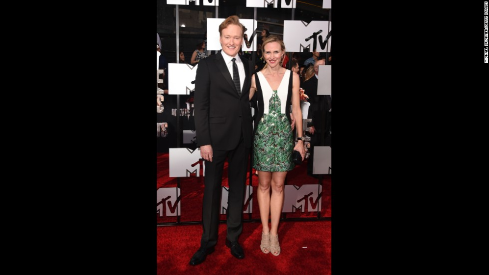 Host Conan O'Brien arrives with Liza Powel at the 2014 MTV Movie Awards on Sunday, April 13, in Los Angeles. Check out the other celebrities as they grace the red carpet.