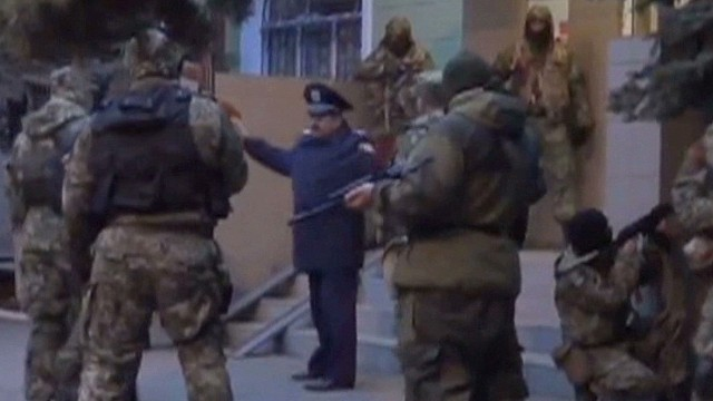 Armed pro-Russians storm police station