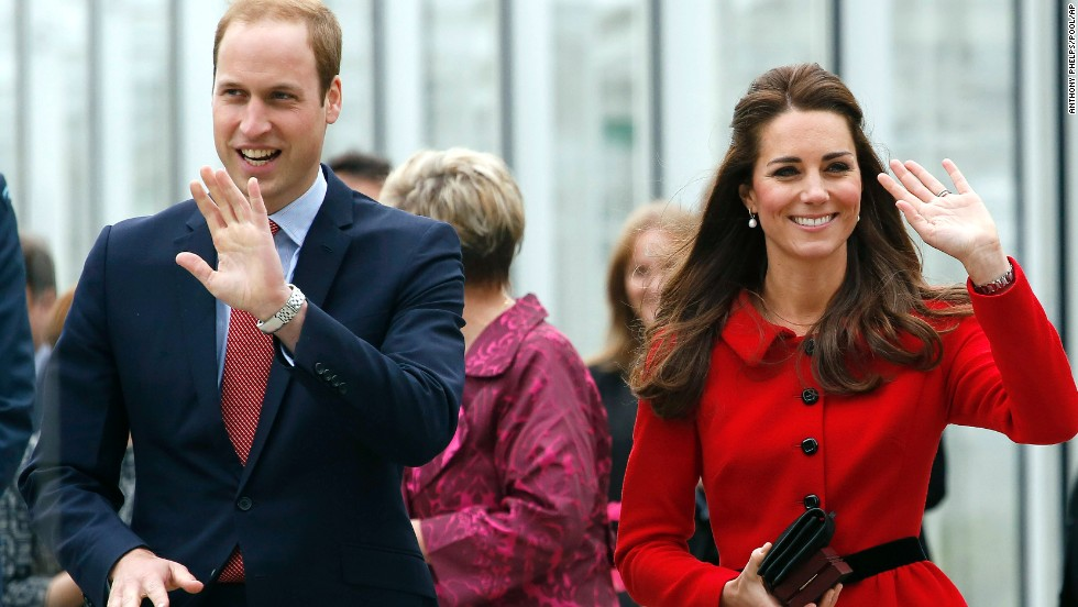 The royal couple wave after their tour of the new visitors center at New Zealand's Christchurch Botanic Gardens on Monday, April 14.
