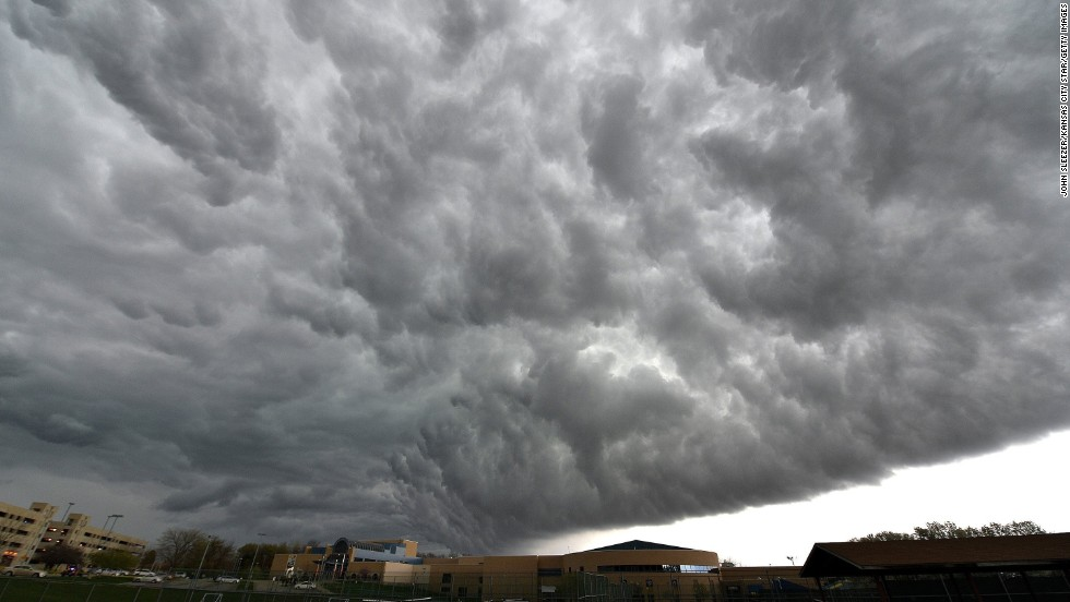Storm clouds gather over the Jewish Community Center of Greater Kansas City on April 13. It was the site of the first shooting.