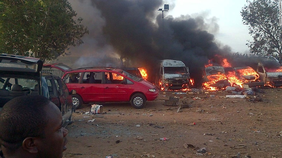 Vehicles are on fire after an explosion Monday, April 14, at a bus station on the outskirts of Abuja, Nigeria. At least 71 people were killed and 124 injured when a parked vehicle exploded at the Nyanya Motor Park bus station, Nigerian officials said.