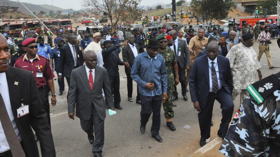 Nigerian President Goodluck Jonathan, wearing the blue shirt and black hat, visits the blast site on April 14.