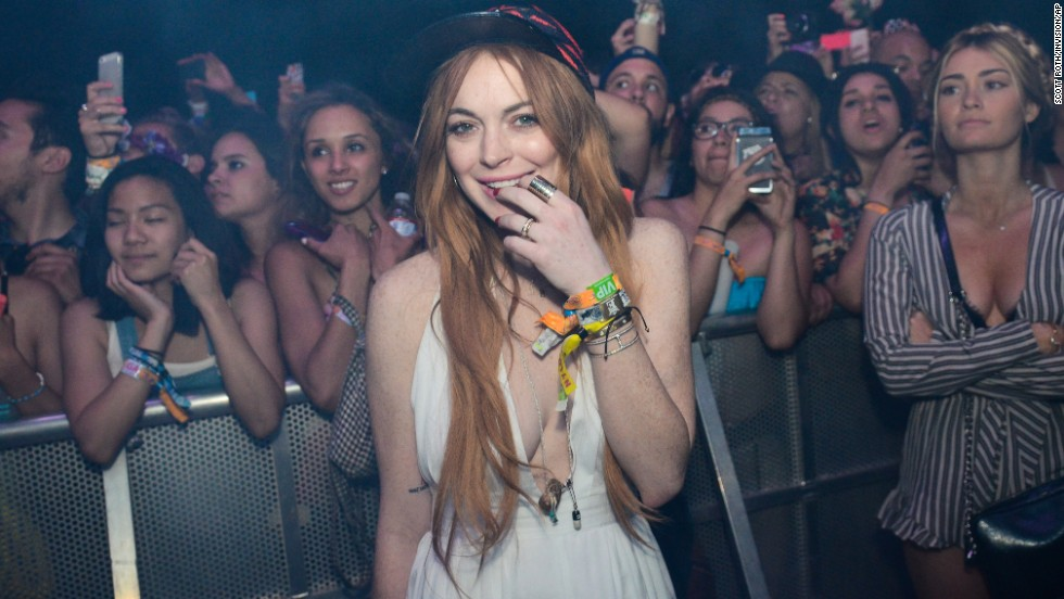 Actress Lindsay Lohan watches Lana Del Rey's performance on April 13.