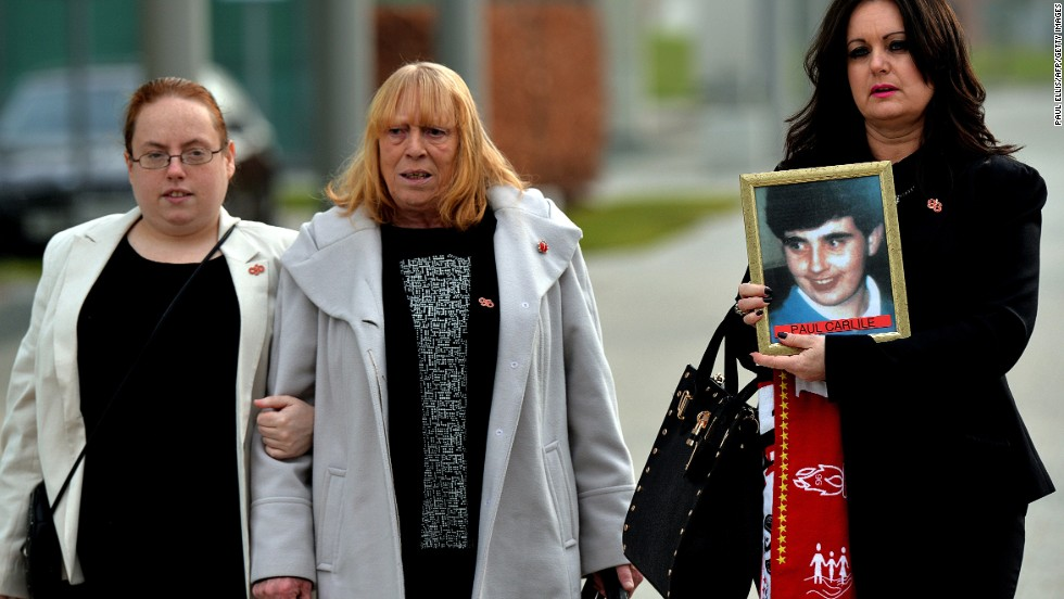 A new inquest into the tragedy started on March 31, 2014. Donna Miller (right), whose brother Paul Carlile died at Hillsborough, walks next to Mary Corrigan (center), whose son Keith McGrath was also killed, as they arrive to attend the opening day.