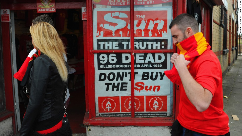 "A poster protesting about the way in which Liverpool fans were blamed for the Hillsborough disaster is displayed outside Anfield in 2012. The club's supporters boycotted ""The Sun"" newspaper due to its coverage of the deaths."