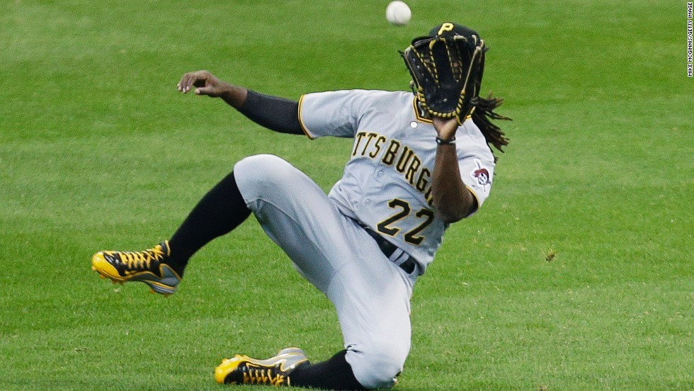 Pittsburgh outfielder Andrew McCutchen makes a diving catch Sunday, April 13, during a Major League Baseball game in Milwaukee.