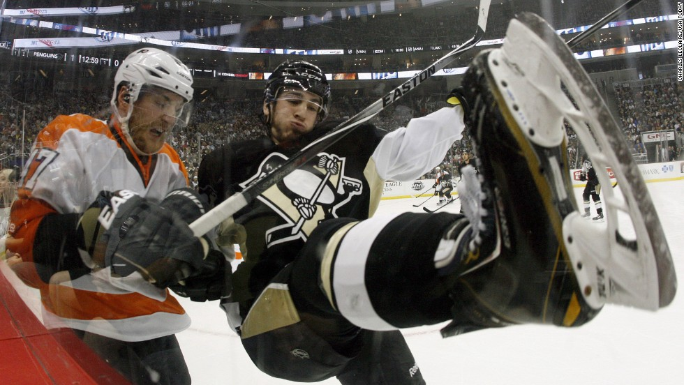 Philadelphia defenseman Andrew MacDonald, left, checks Pittsburgh forward Jayson Megna during an NHL hockey game Saturday, April 12, in Pittsburgh. Philadelphia won 4-3 in overtime.