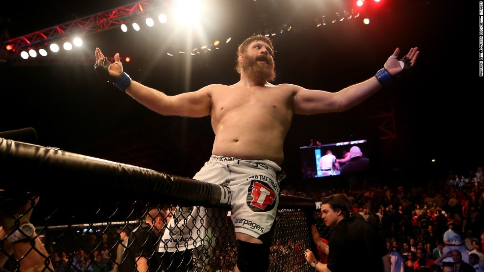 UFC fighter Roy Nelson celebrates on top of the cage Friday, April 11, after knocking out Antonio Rodrigo Nogueira during UFC Fight Night 39. The heavyweight finished Nogueira with a right hand in the first round.