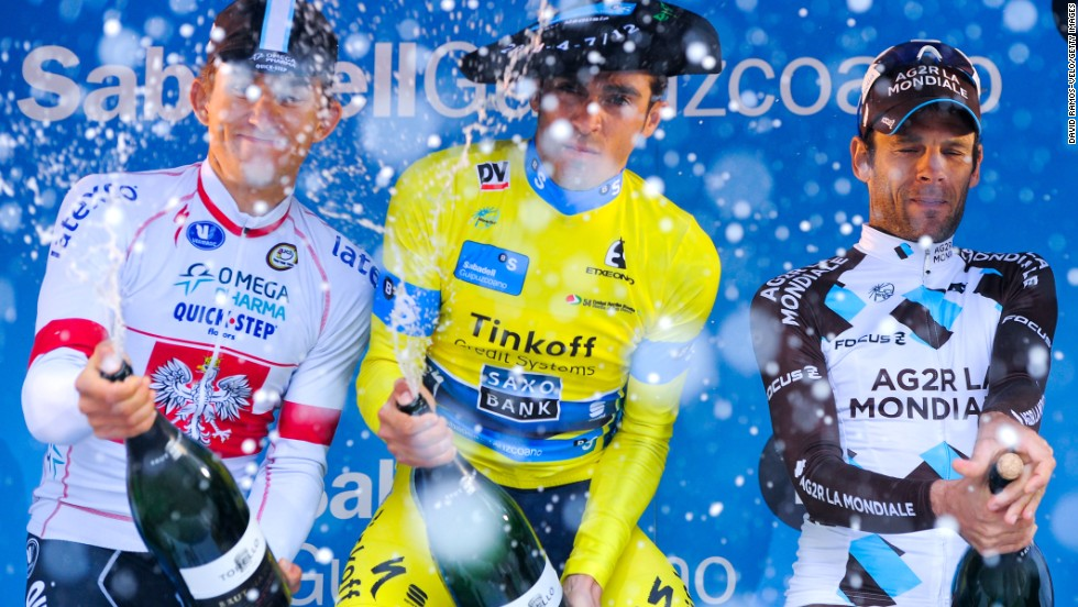 From left, cyclists Michal Kwiatkowski, Alberto Contador and Jean-Christoph Peraud spray cava (Spanish wine) after finishing the last stage of the Vuelta al Pais Vasco event Saturday, April 12, in Markina, Spain. Contador won the race for the third time. Kwiatkowski and Peraud finished second and third overall.<br />