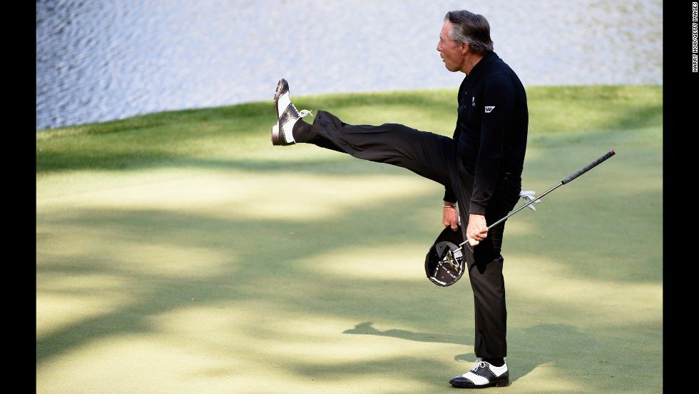 Golf legend Gary Player salutes the gallery Wednesday, April 9, during the annual Par 3 Contest that is held prior to the Masters tournament in Augusta, Georgia. Ryan Moore won the Par 3 Contest but missed the cut during the actual tournament. No Par 3 winner has ever won the Masters in the same year.