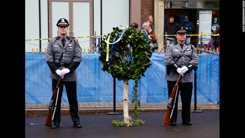 A wreath was laid at one of the bomb sites, under a steady rain on Boston's Boylston Street.