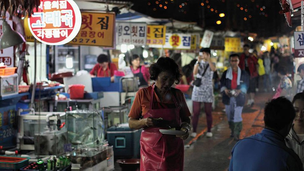 "<strong>Jagalchi Market </strong><br /><br />Tracing its roots to 1889, Korea's largest seafood market is one of Busan's must-visit sights. It's open well into the night. <br /><br />With 480 shops, the market -- shot here by Indy Randhawa -- hosts many festivals throughout the year. Visitors can pick out fresh seafood and have it prepared by vendors to eat on the spot.<br /><br /><a href=""http://travel.cnn.com/seoul/eat/food-map-search-koreas-best-regional-cuisine-391772"" target=""_blank"">READ: Food map: Eat your way around Korea</a>"
