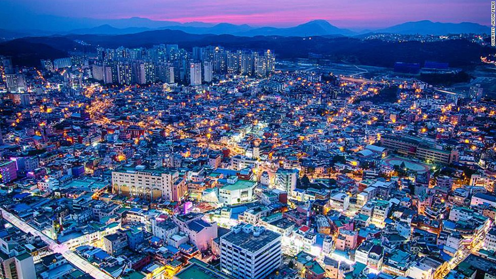 """<strong>Ulsan</strong><br /><br />Home to the <a href=""""http://www.hmmausa.com/our-company/about-hmma/hmc-fact-sheet/"""" target=""""_blank"""">world's largest automobile assembly plant</a> (Hyundai Motor Company)  and the <a href=""""http://www.koreatimes.co.kr/www/news/biz/2013/12/291_69561.html"""" target=""""_blank"""">world's largest shipyard</a> (Hyundai Heavy Industries) and <a href=""""http://petroleuminsights.blogspot.hk/2011/02/worlds-top-21-largest-oil-refineries.html#.U0zjvuaSzMw"""" target=""""_blank"""">the world's second largest oil refinery</a> (SK Energy), Ulsan is indisputably the industrial hub of South Korea. <br /><br />The city's """"old downtown"""" (pictured) in Seungnam-dong is getting a facelift with a recent influx of coffee shops and restaurants. While many residents still live in older-style houses, modern apartments are slowly closing in on the area. <br /><br />Canadian photographer Jason Teale, a 10-year resident of Ulsan and founder of the popular photography blog <a href=""""http://jasonteale.com/blog/"""" target=""""_blank"""">The Sajin</a>, says getting good photos depends on your attitude. <br /><br />""""Be and look friendly,"""" says Teale. """"I have been allowed into a lot of places simply because I smiled and chatted with some people. One time it ended up being the person in charge of the temple who took me to places off limits to most."""""""