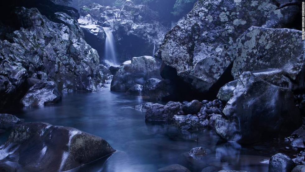 "<strong>Wonang Falls</strong><br /><br />By day, the creek that runs through the valley floor in Donnaeko Resort, Jeju Island, is a brilliant emerald green, says photographer Douglas MacDonald. <br /><br />By night, lit by a full moon, its spectacular rock formations create an otherworldly landscape.<br /><br />Thought to have healing powers for neuralgia (severe pain accompanying damaged nerves) the waterfall is a popular swimming spot. <br /><br /><a href=""http://travel.cnn.com/explorations/play/10-things-do-jeju-island-045157"" target=""_blank"">READ: 10 reasons travelers can't keep away from Jeju Island</a>"