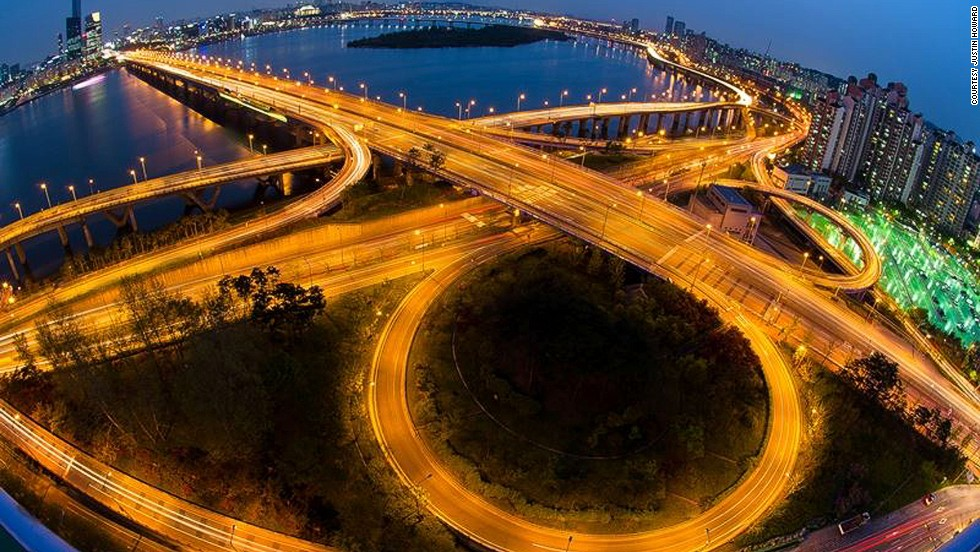 """<strong>Mapo Bridge</strong><br /><br />Of the 27 bridges that connect Seoul's northern and southern sections, Mapo Bridge arguably has the best night views of the city's skyline along the Han River. <br /><br />The bridge has acquired an unfortunate reputation as a <a href=""""While the personal performance hall closed in 2012, """" target=""""_blank"""">symbol for South Korea's high suicide rate</a>. In an effort to deter would-be jumpers, the government has installed lights that flash messages of love and inspiration on the bridge, the effects of which are yet to be studied. <br /><br />Last month, the bridge became a site of filming for the The Avengers: Age of Ultron.<br /><br />""""The bridge can be viewed from ground level at Yeoido but I chose a building rooftop for a more panoramic vista,"""" says Justin Howard, who shot this scene with a fisheye lens """"to really make it jump out.""""<br /><br /><a href=""""http://travel.cnn.com/explorations/none/24-worlds-most-amazing-bridges-062644"""" target=""""_blank"""">MORE: 24 of the world's most amazing bridges </a><br /><br />Peter DeMarco is a writer and photographer living in South Korea."""