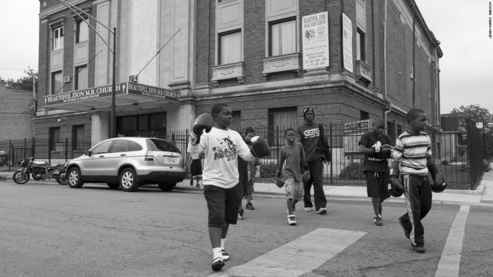 Kids leave the boxing gym to train across the street in Ogden Park. The gym rents the entire third floor of the Beautiful Zion Missionary Baptist Church on 64th Street in Englewood, on Chicago's South Side.