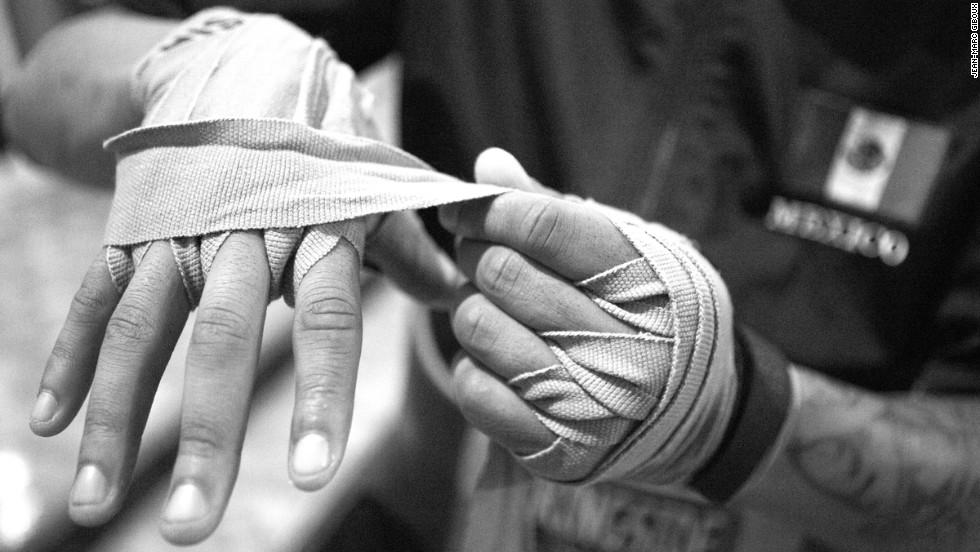 Isiah, 17, wraps his hand before sparring.