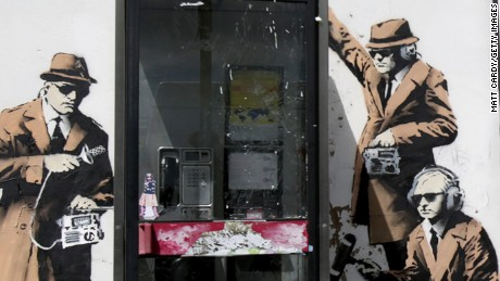 A boy walks past a piece of new graffiti street art on April 14 believed to be by the underground artist Banksy which appeared on the side of a house in Gloucestershire, England.