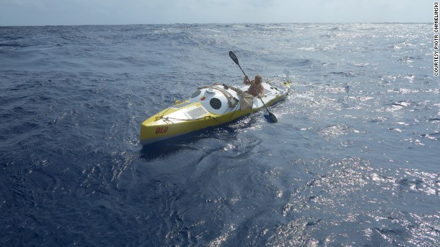 "Olek Doba steers his kayak, ""Olo,"" in the Atlantic Ocean on March 25."