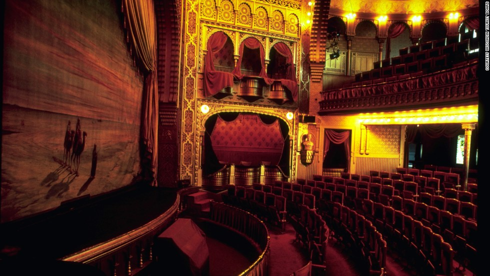 "Within this ""jewel box-like"" theater in Menomonie, Wisconsin, visitors will find stained glass windows, fireplaces, brass, walnut and oak decor and a water-powered pipe organ."
