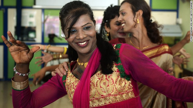 "An Indian transgender resident dances with others at an event to celebrate the Supreme Court judgement in Mumbai recognizing the ""third-gender""."