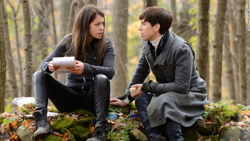 """Outsider Sarah Manning is the main character at the heart of """"Orphan Black."""" She's how we're introduced to the world of clones who look just like her, and we follow her journey to the center of the mystery. Her daughter, Kira (Skyler Wexler, not pictured), is the only child to ever be born to a clone. Sarah's foster brother Felix (Jordan Gavaris, right) quickly becomes the glue keeping the clone sisters, including Alison Hendrix and Cosima Niehaus, together."""